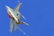 Israeli Air Force (IAF) General Dynamics F-16 in flight with a blue sky background.