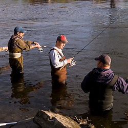 Fisherman casting for shad in the Connecticut River in Holyoke, Masschusetts.