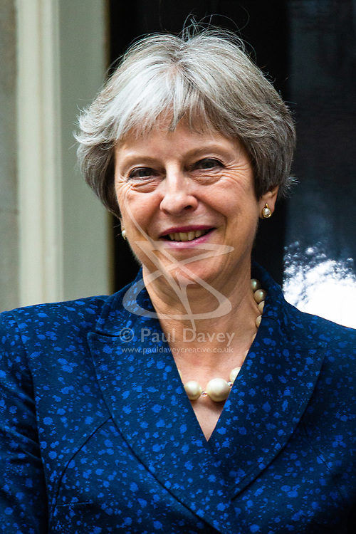 Embattled British Prime Minister outside 10 Downing Street as she welcomes Austrian Chancellor Sebastian Kurz for bilateral talks on the day two key ministers resigned over her Brexit plans.. London, July 09 2018.