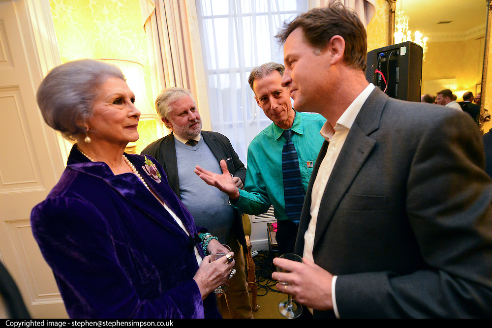 © Licensed to London News Pictures. 11/09/2013. London, UK Nick Clegg (right) talks with April Ashley (Left) , MBE, a transgender model and restaurant hostess. Gary Everett (jumper) of Homotopia and human rights campaigner Peter Tatchell look on. The Deputy Prime Minister, Nick Clegg, hosts a reception at Admiralty House in Whitehall this evening, 11 September 2013, to celebrate the government's progress in equal marriage. From next year gay people will be able to get married. A number of high profile guests including openly supportive celebrities, campaigners, religious figures and charities were in attendance.<br /> The London Gay Men Chorus Ensemble performed at the event. . Photo credit : Stephen Simpson/LNP