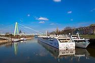 Europa, Deutschland, Koeln, Blick vom Deutzer Hafen zur Severinsbruecke und zum Dom.<br /> <br /> Europe, Germany, Cologne, view from the harbor in the district Deutz to the Severins bridge across the river Rhine and the cathedral.