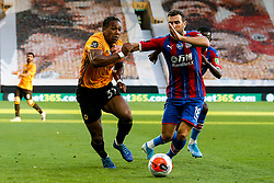 Adama Traore of Wolverhampton Wanderers takes on James McArthur of Crystal Palace - Mandatory by-line: Robbie Stephenson/JMP - 20/07/2020 - FOOTBALL - Molineux - Wolverhampton, England - Wolverhampton Wanderers v Crystal Palace - Premier League