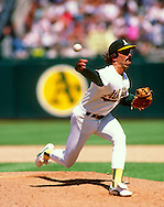 OAKLAND, CA - 1995: Dennis Eckersley of the Oakland Athletics pitches during an MLB game at the Oakland-Alemeda County Coliseum in Oakland, California.  Eckersley pitched for the Athletics from 1987-1995.  (Photo by Ron Vesely)