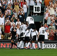 Photo: Steve Bond. <br />Derby County v Portsmouth. Barclays Premiership. 11/08/2007. Matt Oakley is buries as Derby celebrate their early goal