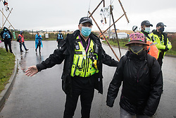 West Hyde, UK. 9th September, 2020. Hertfordshire Police officers invoke Section 14 of the Public Order Act 1986 to clear anti-HS2 activists and press photographers from an area outside an entrance to the Chiltern Tunnel South Portal site for the HS2 high-speed rail link for the entire day. The protest action by anti-HS2 activists, at the site from which HS2 Ltd intends to drill a 10-mile tunnel through the Chilterns, was intended to remind Prime Minister Boris Johnson that he committed to remove deforestation from supply chains and to provide legal protection for 30% of UK land for biodiversity by 2030 at the first UN Summit on Biodiversity on 30th September.