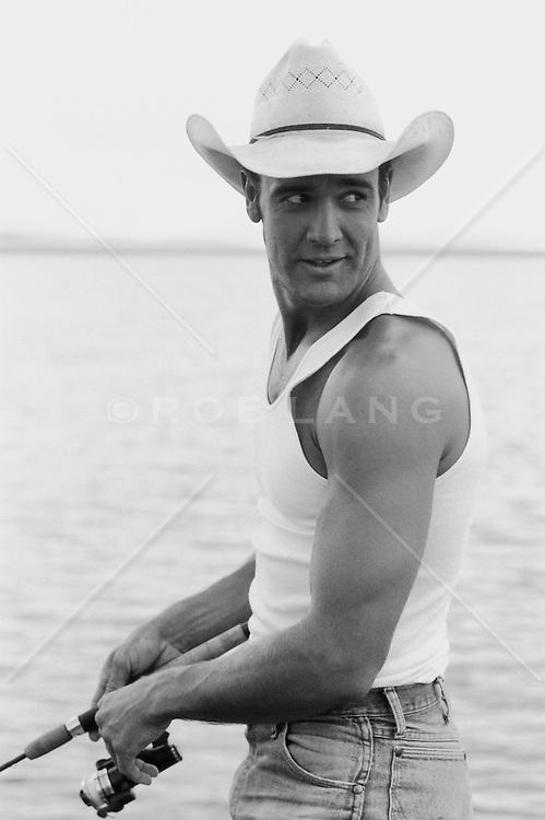 Cowboy in a tank top fishing