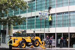 London, UK. 2nd September, 2021. Specialist police officers prepare to use a cherry picker to approach two climate activists from HS2 Rebellion who scaled the Tower Place West building in the City of London in protest against the involvement of insurance company Marsh in the HS2 high-speed rail project. Marsh insure subcontractors working on HS2.