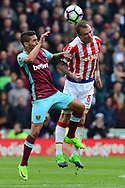 Glenn Whelan of Stoke city ® wins a header.  Premier league match, Stoke City v West Ham Utd at the Bet365 Stadium in Stoke on Trent, Staffs on Saturday 29th April 2017.<br /> pic by Bradley Collyer, Andrew Orchard sports photography.