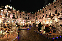 Somerset House reopens adds the  final decorations to its 40ft Christmas tree after the end of the second coronavirus lockdown. visitors will be able to use pop-up private dining domes in the neoclassical courtyard, forming a new festive foodie experience.photo by Roger Alarcon