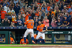 April 13, 2018 - Houston, TX, U.S. - HOUSTON, TX - APRIL 13: Houston Astros center fielder George Springer (4) and Houston Astros second baseman Jose Altuve (27) reacts after Springer hit a lead-off home-run  in the first inning during an MLB game between the Houston Astros and the Texas Rangers and April 13, 2018 at Minute Maid Park in Houston, TX.  (Photo by Juan DeLeon/Icon Sportswire) (Credit Image: © Juan Deleon/Icon SMI via ZUMA Press)