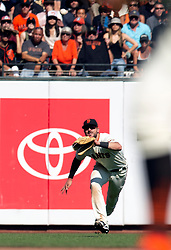 Oct 3, 2021; San Francisco, California, USA; San Francisco Giants left fielder Kris Bryant (23) makes a diving catch of a sinking liner off the bat of San Diego Padres third baseman Ha-Seong Kim during the inning at Oracle Park. The Giants clinched the National League West Division with the win. Mandatory Credit: D. Ross Cameron-USA TODAY Sports