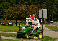 Signs of fall approaching as Joe Lachance is seen mowing the grounds of Elm Street School as preparations get underway for the beginning of the 2018/19 school year.  (Karen Bobotas/for the Laconia Daily Sun)