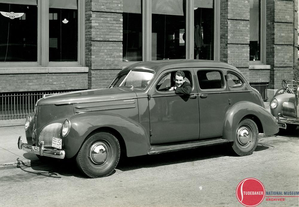 1939 Studebaker Commander sedan outside of Studebaker's Administration Building in South Bend, Indiana.