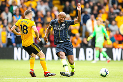 Vincent Kompany of Manchester City is tackled by Diogo Jota of Wolverhampton Wanderers - Mandatory by-line: Robbie Stephenson/JMP - 25/08/2018 - FOOTBALL - Molineux - Wolverhampton, England - Wolverhampton Wanderers v Manchester City - Premier League