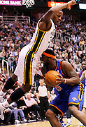 Utah Jazz forward C.J. Miles, left, falls into New York Knicks guard Bill Walker, right, during the first half of an NBA basketball game in Salt Lake City, Wednesday Jan. 12, 2011. (AP Photo/Colin E Braley)