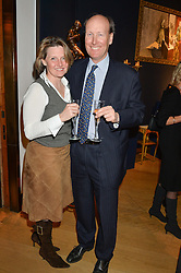 MR & MRS JAMES PALMER-TOMKINSON at a party to celebrate the publication of Interiors For Living by Joanna Wood held at Christie's. 8 King Street, St.James's, London on 2nd March 2015.