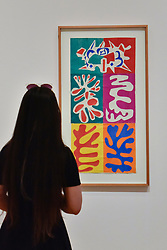 """© Licensed to London News Pictures. 01/08/2017. London, UK. A visitor views """"Panel with Mask"""", 1947.  Preview of """"Matisse in the Studio"""", at the Royal Academy of Arts, Piccadilly, the first exhibition to consider how the personal collection of treasured objects of Henri Matisse were both subject matter and inspiration for his work.  Around 35 objects are displayed alongside 65 of Matisse's paintings, sculptures, drawings, prints and cut-outs.  The exhibition runs 5 August to 12 November 2017.  Photo credit : Stephen Chung/LNP"""