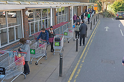 ©Licensed to London News Pictures 26/03/2020<br /> Locksbottom, UK. People queuing at Sainsbury's in Locksbottom near Bromley,South East London. Supermarkets are limiting the number of shoppers in store at any one time. Customers are queuing outside the stores two meters apart for about an hour. The Prime Minister Boris Johnson has asked people to stay at home to help in the fight against Covid-19. Photo credit: Grant Falvey/LNP