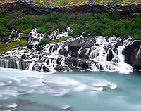 Hraunfossar, a series of waterfalls emerging from beneath a lava flow into the River Hvítá, west Iceland Europe