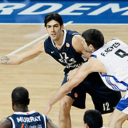 Efes Pilsen's Kerem GONLUM (L) during their Turkish Airlines Euroleague Basketball Top 16 Group G Game 4 match Efes Pilsen between Real Madrid at Sinan Erdem Arena in Istanbul, Turkey, Thursday, February 17, 2011. Photo by TURKPIX