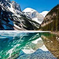 The stunning Lake Louise in Alberta, Canada, brings breathtaking views as the lake thaws.