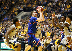 Jan 15, 2018; Morgantown, WV, USA; Kansas Jayhawks guard Sviatoslav Mykhailiuk (10) shoots in the lane during the first half against the West Virginia Mountaineers at WVU Coliseum. Mandatory Credit: Ben Queen-USA TODAY Sports
