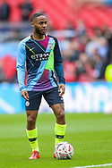 Manchester City midfielder Raheem Sterling (7) warms up during the The FA Cup semi-final match between Manchester City and Brighton and Hove Albion at Wembley Stadium, London, England on 6 April 2019.