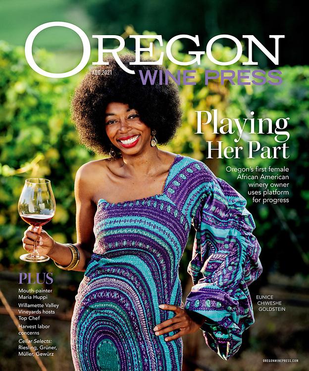 A portrait of Eunice Chiweshe Goldstein, Oregon's first black female winemaker at Francis Coppola's Oregon vineyard, Domaine de Broglie.  She is wearing a dress by designer Komi Jean Pierre Nugloze