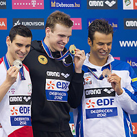 Silver medalist Gergo Kis (L) of Hungary, gold medalist Paul Biedermann (Center) of Germany and bronze medalist Samuel Pizzetti (R) of Italy celebrate their victory in the men's 400m freestyle final of the 31th European Swimming Championships in Debrecen, Hungary on May 21, 2012. ATTILA VOLGYI