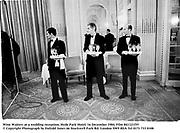 Wine Waiters at a wedding reception. Hyde Park Hotel. 16 December 1984. Film 841121f35<br />© Copyright Photograph by Dafydd Jones<br />66 Stockwell Park Rd. London SW9 0DA<br />Tel 0171 733 0108