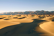 Sand dunes at sunrise with Funeral Mountains in the background.Death Valley National Park, California
