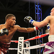 TAMPA, FL - FEBRUARY 28:  Clarence Booth (L) punches Osenohad Vazquez during the SoloBoxeo Tecate boxing match at the University of South Florida Sundome on February 28, 2015 in Tampa, Florida. Booth won the bout by knockout.  (Photo by Alex Menendez/Getty Images) *** Local Caption *** Clarence Booth; Osenohad Vazquez