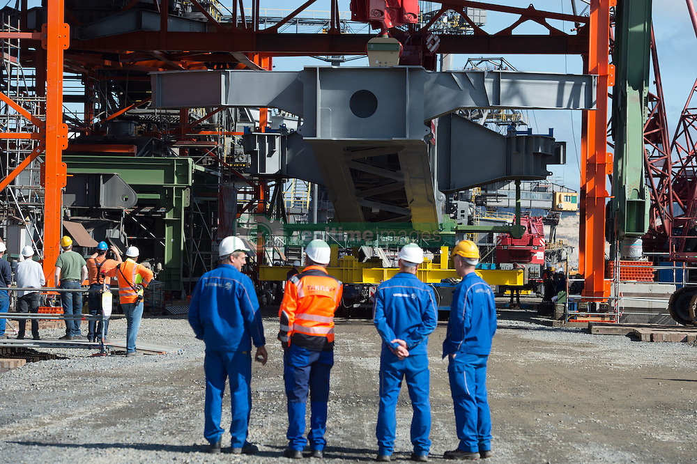 September 6, 2016 - Boxberg, Saxony, Germany - Construction workers follow the preparations for the installation of the large lever (Grosse Schwinge) on the F60 conveyor bridge at the Nochten strip mine in Boxberg, Germany, 06 September 2016. In order to replace two parts - the large lever and the roller table that lies above it - the conveyer belt will be closed for a total of 13 weeks and will be in operation again starting 22 October. Photo:SEBASTIANKAHNERT/dpa (Credit Image: © Sebastian Kahnert/DPA via ZUMA Press)