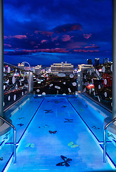 Welcome to the world's most expensive hotel suite — a stunning two-storey palace in the sky overlooking the Las Vegas strip, costing $100,000-a-night. The Palms has just unveiled the jewel in the crown of its ongoing $690million refurbishment of the casino resort — the Empathy Suite, a Sky Villa designed by and featuring the works of world-renowned English artist Damien Hirst, aged 53. The Empathy Suite sprawls over 9,000 square-feet and two floor and features a butterfly-motif mosaic tiled pool overlooking the strip, a vast collection of art including any original works by Hirst, a 13-seat curved glass bar top encrusting medical waste art, along with two lounge and theater areas that accommodate up to 52 guests. There's also Hirst-desined furniture, drapery, carpeting and serpentine-shaped Italian leather sofas with the butterfly motif. Above the centre bar is Hirst's Here for a Good Time, Not a Long Time (2018) art piece – a marlin skeleton in a vitrine and taxidermy marlin in another. The opulent dining area seats eight people, while both master bedrooms come complete with California-King beds, massive closets and bathrooms with double sinks and theatrical lighting. The villa also boasts a powder room, a salt healing room, a fitness center and two massage rooms, while the outdoor area features a pool and panoramic views of Sin City. A stay at the suite — which is reserved for millionaire high-roller gamblers, also involves a highly personalised and exclusive guest experience while at the property, including 24-hour butler service, over-the-top welcome amenities and a private behind-the-scenes art tour of the suite and entire property. There's also a chauffeured car service throughout the stay and A-list access to Palms' premier amenities such as KAOS Dayclub & Nightclub, the Pearl Concert Theater and the Palms' world-class recording studio and a $10,000 credit to use at the resort. The Sky Villa contains six original works from Hirst including