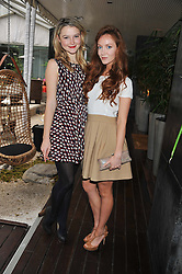 Left to right, AMBER ATHERTON and OLIVIA GRANT at a tea party organised by The Hub Magazine in aid of charity Kids Company held at The Sanderson, Berners Street, London on 2nd May 2012.