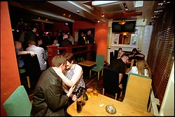 Couple kissing in quiet corner of busy noisy disco bar Newcastle UK