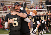 Lone Peak's Talon Shumway (6) is consoled by a coach after the Utah State High School 5A Football semifinal between Lone Peak and Jordan in Rice-Eccles Stadium, Thursday, Nov. 8, 2012.