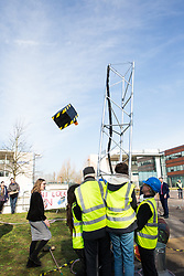 Windsor, UK. 22nd February, 2019. Around 60 campaigners from Reclaim the Power and Fuel Poverty Action dismantle a mock fracking site during a family-friendly protest outside the headquarters of Centrica to call on the British multinational energy and services company to cease its support for fracking operations through its partnership with shale gas company Cuadrilla Resources.