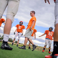 081215       Cable Hoover<br /> <br /> New head coach Josh Olsen give his players instructions during football practice at Gallup High School Wednesday.