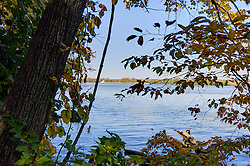 11 October 2015:   View of a tug boat using several barges up the Illinois River from the river trail at Starved Rock State Park between Owl Canyon and Lasalle Canyon. Scenics from along the Illinois River Scenic Road and sites along the drive.  All images were between Ottawa and East Peoria.<br /> <br /> This image was produced in part utilizing High Dynamic Range (HDR) processes.  It should not be used editorially without being listed as an illustration or with a disclaimer.  It may or may not be an accurate representation of the scene as originally photographed and the finished image is the creation of the photographer.