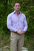 © Licensed to London News Pictures. 02/07/2012. East Molesey, UK. Dr Christian Jessen from Channel Four Embarrassing bodies TV programme. The RHS Hampton Court Palace Flower Show 2012. The show runs 3-8 July, 2012. Photo credit : Stephen Simpson/LNP
