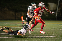Drew Muzzey breaks free from Pembroke's Kyle Roukey during Friday night's Homecoming game under the lights at Jim Fitzgerald Field.  (Karen Bobotas/for the Laconia Daily Sun)