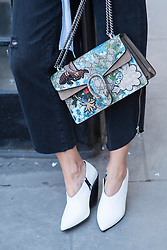Silvia Garcia (Bartaba blog) with a Gucci designed bag during London Fashion Week Autumn/Winter 2017 in London.  Picture date: Friday 17th February 2017. Photo credit should read: DavidJensen/EMPICS Entertainment