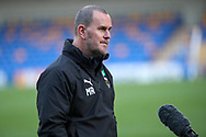 AFC Wimbledon manager Mark Robinson talking into microphone during the EFL Sky Bet League 1 match between AFC Wimbledon and Hull City at Plough Lane, London, United Kingdom on 27 February 2021.