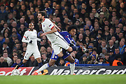 Chelsea attacker Willian (22) fouling Paris Saint Germain midfielder Thiago Motta (8) during the Champions League match between Chelsea and Paris Saint-Germain at Stamford Bridge, London, England on 9 March 2016. Photo by Matthew Redman.