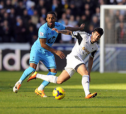 Tottenham Hotspur's Danny Rose tackles Swansea City's Alejandro Pozuelo - Photo mandatory by-line: Joe Meredith/JMP - Tel: Mobile: 07966 386802 19/01/2014 - SPORT - FOOTBALL - Liberty Stadium - Swansea - Swansea City v Tottenham Hotspur - Barclays Premier League