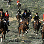 Members of a fox hunting club participate in a hunt near Fort Tejon in California.