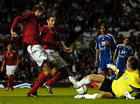 Photo: Daniel Hambury.<br />England v Greece. International Friendly. 16/08/2006.<br />England's Peter Crouch (L) scores to make it 3-0.