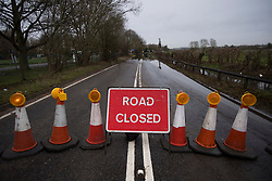 © Licensed to London News Pictures. 03/02/2021. Old Windsor, UK. The Windsor Road closed between Windsor and Staines, where the River Thames has broken it's banks. Large parts of the UK experience more wet conditions which is expected to bring further flooding. Photo credit: Ben Cawthra/LNP