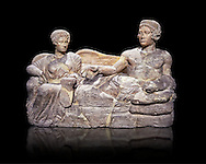 Etruscan cinerary, funreary, urn cover depicting a husband and wife,  from the Padata Necropolis, Chianciano, end of 5th century B.C., inv 94352 National Archaeological Museum Florence, Italy , black background .<br /> <br /> If you prefer to buy from our ALAMY PHOTO LIBRARY  Collection visit : https://www.alamy.com/portfolio/paul-williams-funkystock - Scroll down and type - Etruscan Florence - into LOWER search box. (TIP - Refine search by adding a background colour as well).<br /> <br /> Visit our ETRUSCAN PHOTO COLLECTIONS for more photos to download or buy as wall art prints https://funkystock.photoshelter.com/gallery-collection/Pictures-Images-of-Etruscan-Historic-Sites-Art-Artefacts-Antiquities/C0000GgxRXWVMLyc